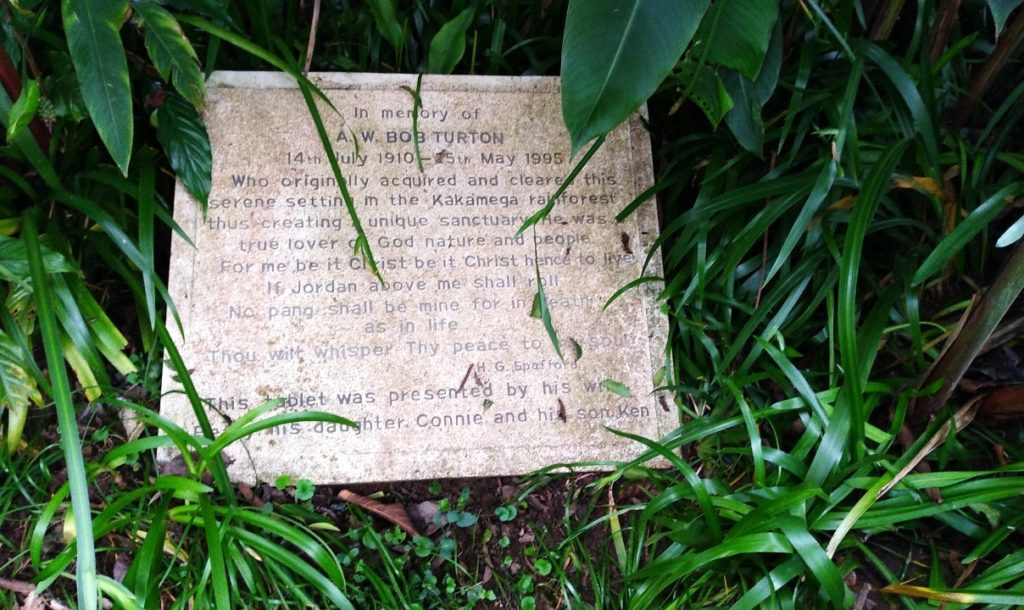 A memorial plaque within the lawn